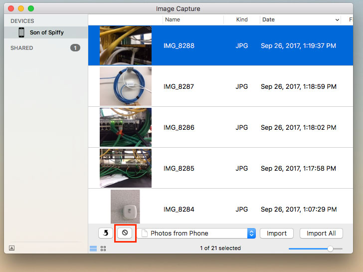 An image displaying the Image Capture window with a list of boring photos on an iPhone.